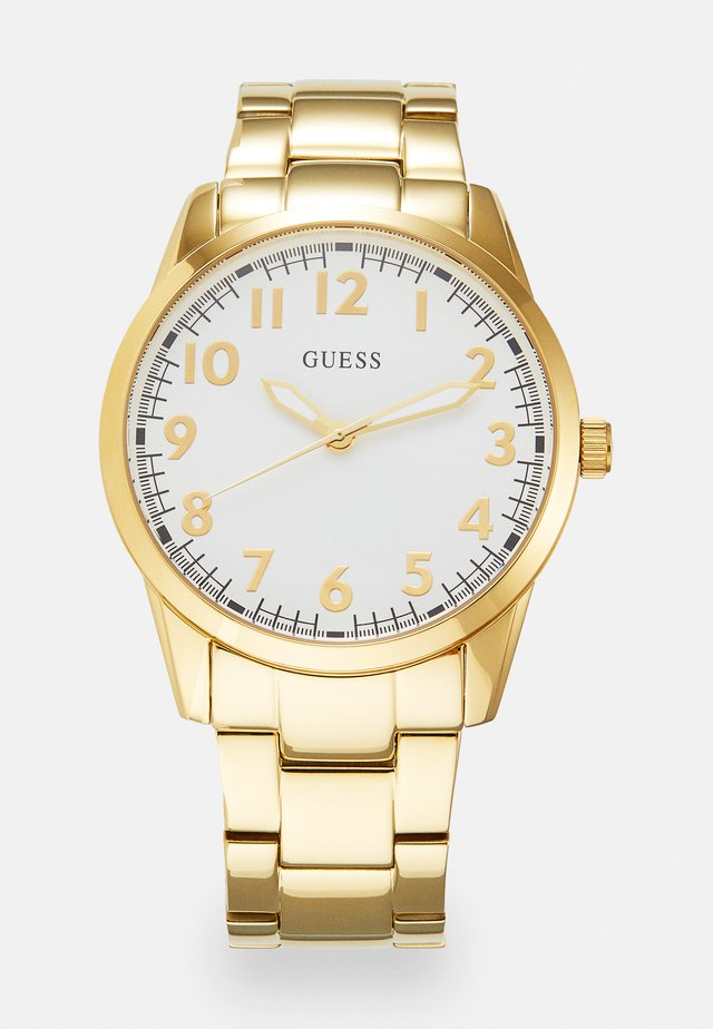 Montre - gold-coloured
