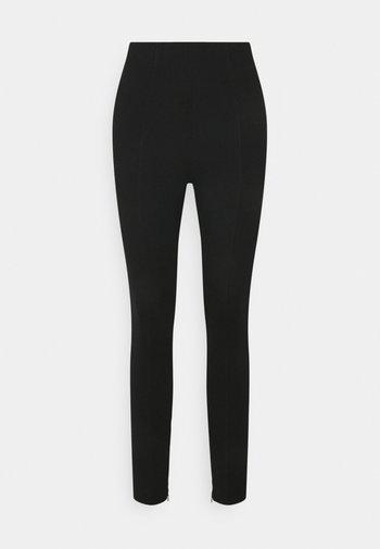 ISSA PUNTO - Leggings - Trousers - black