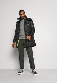 Diesel - W-RUSSELL-LONG-THERMO JACKET - Winter jacket - black - 1
