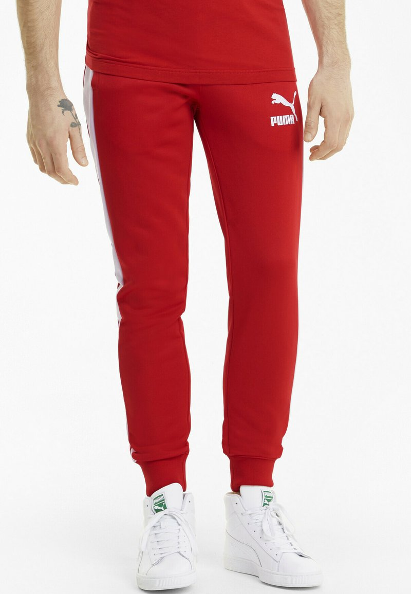 Puma - ICONIC - Tracksuit bottoms - high risk red