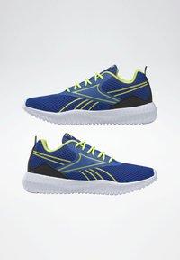 Reebok - REEBOK FLEXAGON ENERGY SHOES - Neutral running shoes - blue - 5