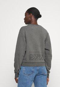 Guess - GRAFFITI  - Sweatshirt - coldjet black - 2