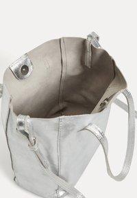 OYSHO - METALLIC LEATHER MINI SHOPPER - Handbag - silver - 3
