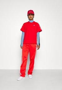 adidas Originals - ADIBREAK - Pantalones deportivos - red - 4