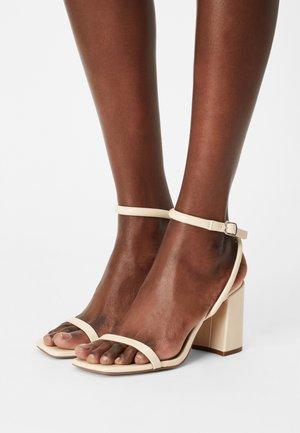 Sandali - beige
