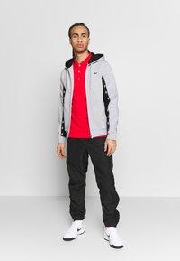 Lacoste Sport - TENNIS PANT TAPERED - Spodnie treningowe - black - 1