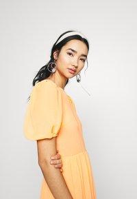 Never Fully Dressed - TIERED SHEER MIDI DRESS - Denní šaty - orange - 3