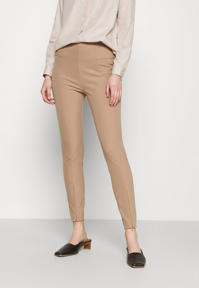 ADANIO - Trousers - chanterelle