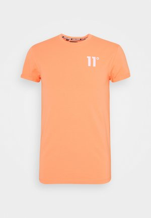 MUSCLE FIT - Print T-shirt - coral peach