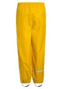 CeLaVi - RAINWEAR PANTS  RAINWEAR UNISEX - Rain trousers - yellow - 1
