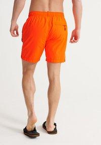 Superdry - SUPERDRY SWIMSPORT SHORTS - Swimming shorts - bright havana orange - 2