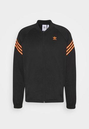 SWAROVSKI TRACK UNISEX - Sportovní bunda - black/trace orange