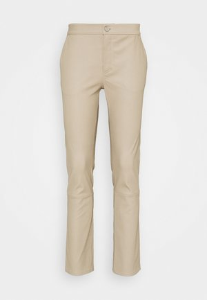 LEYA - Leather trousers - chickpea