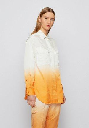 BAWAKI - Button-down blouse - patterned