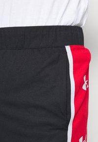 Under Armour - BASELINE RETRO - Sports shorts - black - 3