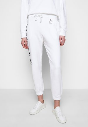 ENOLOGIA - Tracksuit bottoms - white