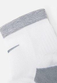 Nike Performance - SPARK CUSH ANKLE UNISEX - Sports socks - white/reflective - 1