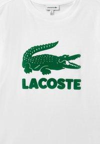 Lacoste - T-Shirt print - blanc/vert - 2