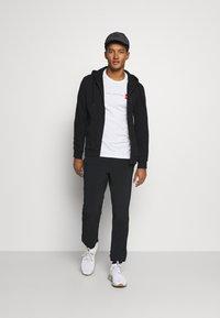 Peak Performance - GROUND ZIP HOOD - Zip-up hoodie - black - 1