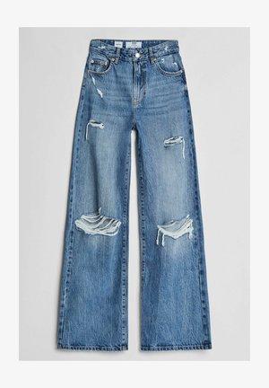 MIT SCHLAGHOSE UND RISSEN - Relaxed fit jeans - dark blue