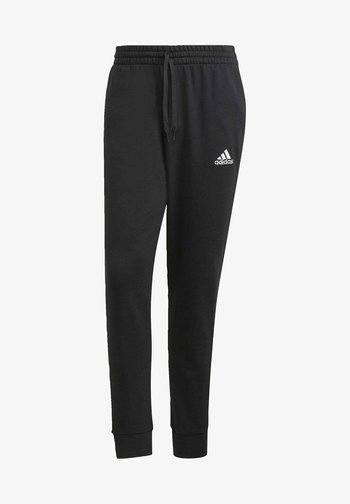 SL ESSENTIALS SPORTS FRENCH TERRY PANTS - Tracksuit bottoms - black
