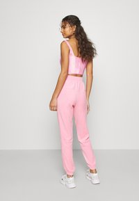 adidas Originals - JOGGER - Tracksuit bottoms - lightpink - 2