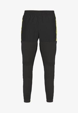 FTBLNXT PRO PANT - Tracksuit bottoms - black/ultra yellow
