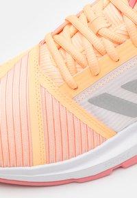 adidas Performance - COURTJAM BOUNCE - Multicourt tennis shoes - acid orange/silver metallic/haze rose - 5