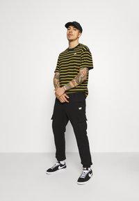 Caterpillar - Pantalones deportivos - black - 1