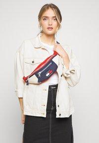 Tommy Jeans - HERITAGE BUMBAG - Bum bag - blue - 1