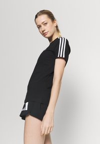adidas Performance - T-shirts med print - black/white - 3