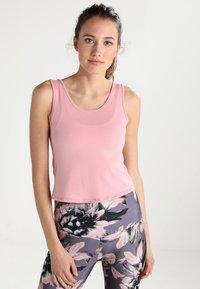 Onzie - KNOT CROP - Sports shirt - blush - 0