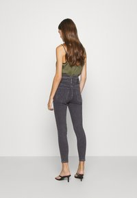 Levi's® - MILE HIGH ANKLE WAIST - Jeansy Skinny Fit - black denim - 2