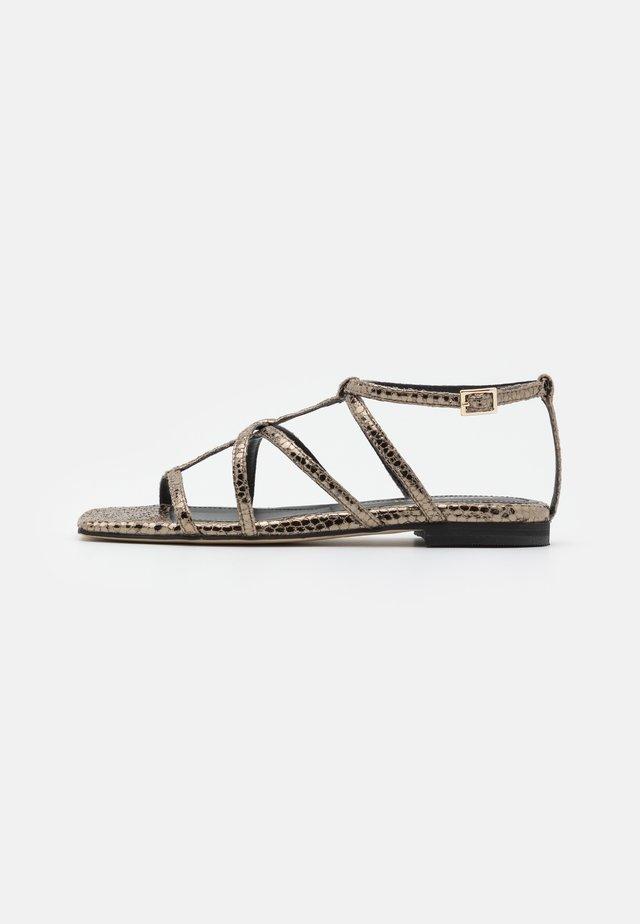 Sandaler - metal papua alba