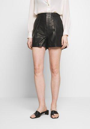KATHI - Shorts - black