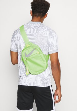 CROSSBODY  - Ryggsäck - barely volt / reflective