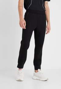 Neil Barrett BLACKBARRETT - ELONGATED ZIP  - Pantalon de survêtement - black - 0