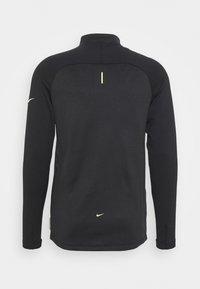 Nike Performance - STRIKE WINTERIZED - Training jacket - black/volt - 1