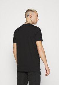 Ellesse - MAGI - Print T-shirt - black - 2
