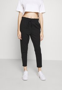 ONLY Petite - ONLPOPTRASH EASY FRILL PANT - Trousers - black - 0