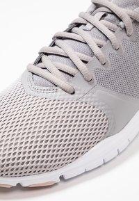 Nike Performance - WMNS NIKE FLEX ESSENTIAL TR - Sports shoes - atmosphere grey/pink quartz/echo pink/vast grey/white - 5