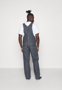 Carhartt WIP - TRADE OVERALL - Jeans Relaxed Fit - dark navy/wax rinsed - 2