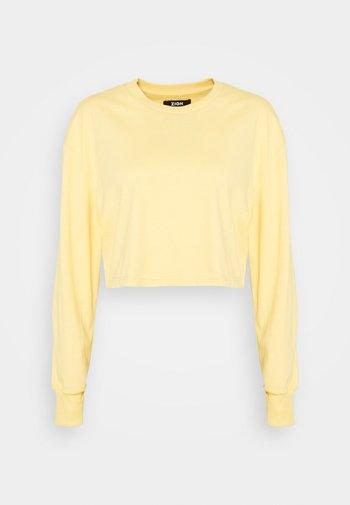 Botanical dyed - Langærmede T-shirts - light yellow