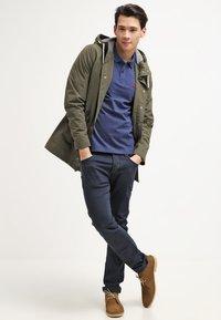 Selected Homme - SLHARO EMBROIDERY - Polo shirt - dark blue melange - 1