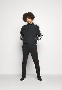 adidas Performance - Träningsbyxor - black/scarlet - 1