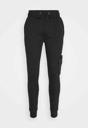 HOUDINI - Tracksuit bottoms - jet black