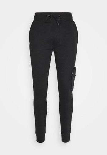HOUDINI - Pantaloni sportivi - jet black