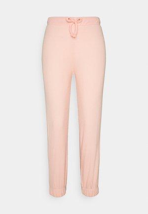 LOUNGE JOGGER - Tracksuit bottoms - pink