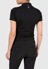 J.LINDEBERG - TOUR TECH - Sports shirt - black - 1
