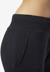 Reebok Classic - CLASSICS VECTOR BIG LOGO PANTS - Tracksuit bottoms - black - 2